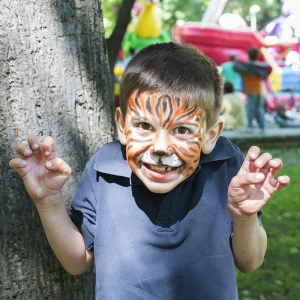 Child with painted face having fun at AZ Fall Festival